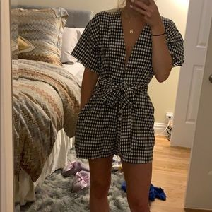 Olivaceous black and white checkered romper
